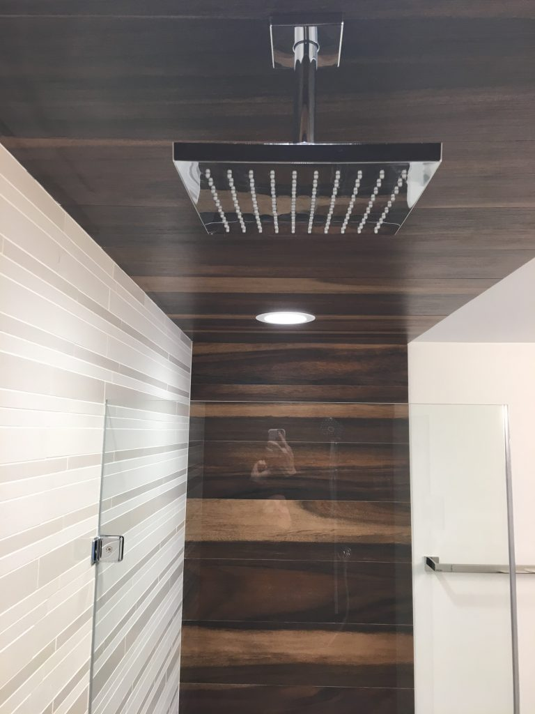 Rain shower with custom tile and glass enclosure