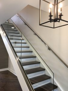 Custom staircase with Glass railing and Steel handrail