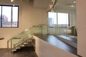 Elevated Executive Office with Metal Staircase and Glass Enclosure